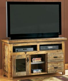 """Mountain Woods Furniture® Wyoming Collection™ 54"""" TV Console Made of reclaimed, weathered wood and select hardwoods Assembled in the USA by skilled artisans Varying knot patterns and grain; no two are alike Available bronze or antler handles"""