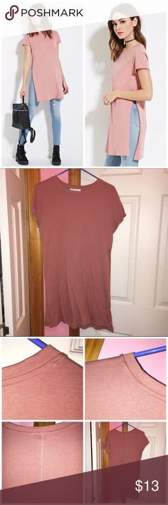 "⚡️1 HR SALE⚡️ High-Slit Longline Tee Never worn; just washed. Rose color t-shirt. Longline silhouette. High slits on both sides. Cuffed short sleeves. Round neckline. 60% cotton and 40% modal. Approx 32"" in length and bust is approx 37"". ❌NO TRADES❌ Forever 21 Tops Tees - Short Sleeve"