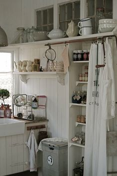 source: Hvitur Lakkris. just for ideas. Was thinking the shallow shelves will work maybe in the hallway from the garage???