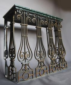 A steel, wrought iron and marble topped console table,
