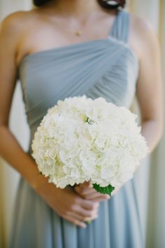 All-white hydrangea wedding bouquet: http://www.stylemepretty.com/collection/2028/