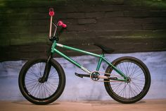 Frame: Total BMX Voltron V2 Forks: Total BMX GS forks Bars: Total BMX GS bars Grips: ODI Longneck Cranks: Total BMX Hangover cranks Pedals: Colony Plastic pedals Seat: Total BMX fat seat Front wheel: HaloPriest Rim , Halo double butted spokes , Halo MXF hub. Front tyre: KHE Mac 2 Back wheel: Halo Priest , Halo double butted spokes , Halo MXR hub Back tyre: KHE Mac 1.5 Pegs: Total BMX Skinnies  source: http://www.vitalbmx.com/features/Bike-Check-Jack-Watts,4164