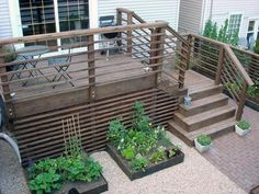 If your deck or porch is elevated, even a little, above grade level, it's best to polish off the underside with landscaping, skirting or other methods. Find and save ideas about Deck skirting ideas on here. Deck Stairs, Deck Railings, Horizontal Deck Railing, Railing Ideas, Stair Railing, Deck Railing Design, Cable Railing, Cool Deck, Diy Deck