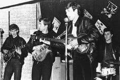 The Beatles performing in a club in Liverpool in 1962, before they had signed their first recording contract