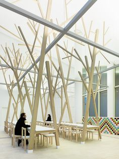 Estudio Nômada created an abstract forest in their design of the cafeteria and museum shop within the Cidade da Cultura de Galicia (Galician City of Culture). Designed by Peter Eisenman.