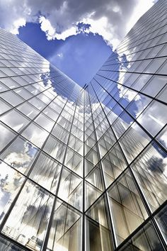 Building reflections by Laurent photography, via Flickr