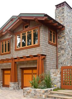 Exposed rafter tails are crisply rendered on a new Craftsman-style house in southern California. Photo: William Wright