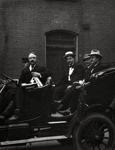 Edward F. Goltra, an unidentified delegate, Rolla Wells, and William Jennings Bryan arriving at a session of the 1916 Democratic National Convention, St. Louis, 11-14 June 1916. Missouri History Museum