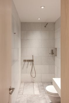 """How a Simple Bathroom Renovation Turned Into an Entire Apartment Overhaul: Night and day! The small bathroom, which originally had dark tiles, has been converted into a bright, open wet room. """"David knew he wanted a Japanese bidet toilet and the Scandinav Ada Bathroom, Mold In Bathroom, Office Bathroom, Small Bathroom Storage, Steam Showers Bathroom, Upstairs Bathrooms, Bathtub, Bathroom Ideas, Simple Bathroom"""
