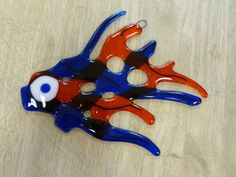 Fishy suncatcher or component for another piece.  Would look cool on a sushi plate!