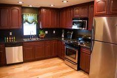 mobile home remodeled kitchen. I LOVE LOVE LOVE darker wood cabinets!