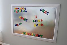 Love this playroom with an Alphabet letter wall and a magnet wall frame.  Perfect for little kids