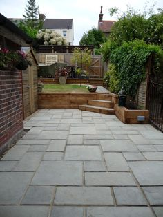Courtyard paving with Oak sleeper retaining wall Portslade East Sussex Arbwo Small Garden Retaining Wall, Sloped Garden, Patio Steps, Garden Steps, Patio Tiles, Concrete Patio, Sleeper Retaining Wall, Retaining Walls, Brighton
