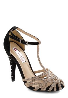 I love anything with rhinestones, and anything with a T-strap.  I think they made this shoe for me.