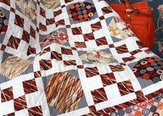 """Wendy Sheppard's """"Curious Cats"""" quilt using our """"Ziggy Cat"""" collection"""