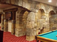 Another concrete basement from Vertical Artisan - stones hand carved from vertically applied concrete.