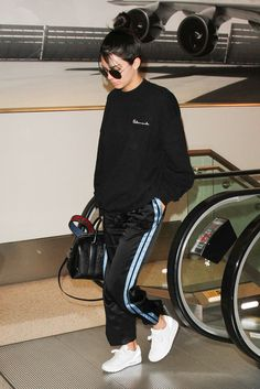 Kendall Jenner arriving in Paris for Fashion Week looking super luxe in her Vetements sweatshirt and striped tracksuit trousers. Kenny, we salute you…