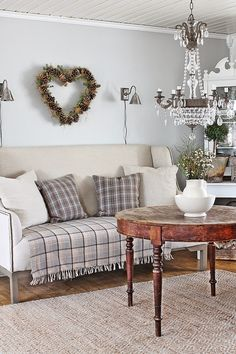 Winter decorating...love the heart pinecone wreath