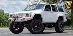 For sale in our Orlando, Florida showroom is a White 1997 Jeep Cherokee Sport 4.0L I6 FI Automatic . Click for more details.