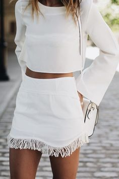 white total look. Short skirt and white blouse.