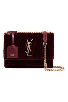 Saint Laurent's small 'Sunset' bag is updated in a rich burgundy velvet for the new season. Lined on the inside with soft merlot leather and finished with the label's iconic 'YSL' plaque, it has a gold sliding chain strap and is separated into two compartments large enough to fit a phone, keys and compact. It also has a small card slot and slit pocket beneath the flap so you can easily access your essentials.Shown here with: [Saint Laurent Dress id1068844], [Saint Laurent Pumps id1069133]… Ysl Purse, Ysl Bag, Fashion Handbags, Purses And Handbags, Fashion Bags, Fashion Outfits, Luxury Purses, Luxury Bags, Saint Laurent