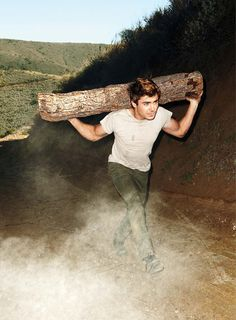Zac Efron - I'm not sure why you're carrying a log... But you look good doing it.