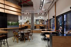 I love the industrial look Levy:Chamizer Architects studio realized for Giraffe Restaurant from Tel Aviv, Israel. As you can see from the photos below, th Cafe Design, Interior Design Studio, Cool Restaurant, Restaurant Interiors, Douglas Fir, Tel Aviv, Giraffe, Concrete, Israel