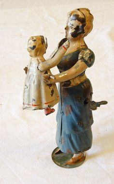 Gunthermann Woman with a baby Wind Up toy from 1890s  ebay
