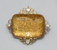A citrine and diamond panel brooch.