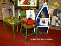 Andrea Guerriero - DRE DESIGNS www.dredesigns.ca Canoe bookcase and canvas art done with Annie Sloan Old White & Napoleonic Blue with clear wax, Chair and base of bench seat done in Antibes Green with clear and dark waxes, fabric on bench seat is a DRE DESIGNS custom fabric