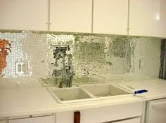 Glass mosaic backsplash tile may work very well above kegerator in dining room perhaps?