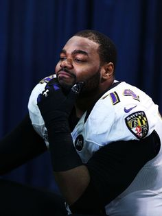 """Michael Oher is an American NFL football player but is widely known because he was the subject of the 2006 book """"The Blind Side"""", which followed in becoming a movie and the life story of the player was revealed to the world. The movie stated Oher being homeless in his teenage years and had no place to go or had no one to look after him. He was adopted by a family who became very much supportive and brought out his hidden talents which were playing football."""