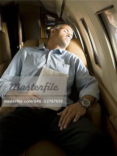 A businessman sleeping in an airplane