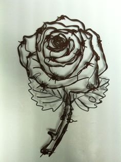 This is a rose made from old rusty Barbed wire. I can do any plant that's your favorite, and can have yours painted in any color.