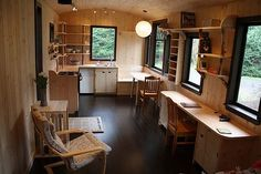 Tiny house interior. Notice rounded edges throughout....another small detail that saves a little space. Like the desk