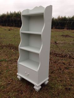 Cashmere Gray by Benjamin Moore -  Nursery Bookcase with ornate feet and drawer on Etsy, $400.00