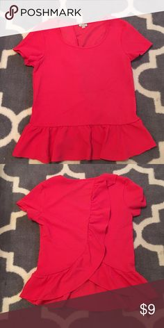Coral peplum top with ruffle back Absolutely adorable coral top! Ruffle peplum hem, the back has a beautiful ruffle down it that turns into a tulip back. Great for work with a skirt or slacks, also looks cute with some dark high waisted jeans! Tried on but never worn, size medium with a good bit of stretch. Eyeshadow Tops Blouses