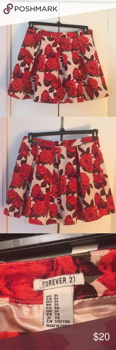 """Romantic Red Rose Pleated Mini Skirt 🌹🌹🌹 Super sweet red rose mini skirt from Forever 21 Pleats in front and back Size US - 31, can fit M/L easily. Model's waist is 32 cm Length: Approx 40 cm  Model is approximately 5'6"""", reaches mid thigh Worn, but looks new!!✨ Polyester cream-colored lining Stain free on outside, Red ink stain on internal lining Forever 21 Skirts Mini"""
