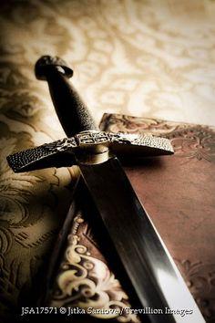 Trevillion Images - medieval-sword-leather-book