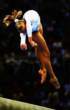 Nastia Liukin in the middle of an Onodi...........................Gymnastics the extreme sport!