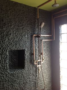 Mancave open shower, exposed copper plumbing.