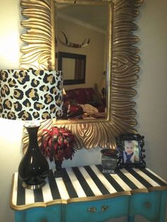 love that table - turquoise blue, black & white stripes, and gold trim