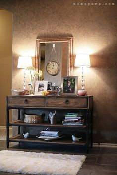 Our wooden console table integrates perfectly into this modern rustic foyer makeover