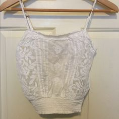 White cropped tank Super cute cropped white tank with smocking on the bottom and pretty stitched detailing. No stains or pulls in the fabric, only worn a couple of time Abercrombie & Fitch Tops Crop Tops