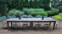 Seat everyone at one big table. Who wouldn't love coming into a backyard set up like this? Put two or three tables together if you have to — the dramatic effect will be worth the effort.