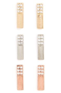 Glass crystals add subtle sparkle to this set of delicate bar earrings in gold, rose gold and silver.