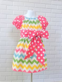 Girls Handmade Chevron Peasant Dress  Dress is shirred at the waist and sleeves. Sash is unattached.  Dress available in the following sizes 9-12