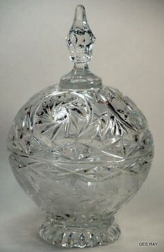 This is a gorgeous footed covered etched crystal vase bowl compote. Could be used as candy jar as well. Cut glass etched with roses, leaves and stars.