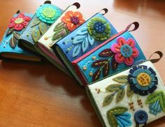 oh, my--these felt needle cases are lovely!  I was just looking for a photo to remind myself--I'd like to make needle cases for each of the kids--maybe embroidered with their names? and in their felt color? to store needles--could be pre-threaded for current projects, and sized according to ability