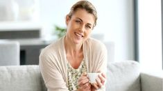 Middle-aged woman sitting in sofa, holding cup of coffee Daily News, Royalty Free Photos, Clip Art, Stock Photos, Couple Photos, Health, Blog, Women, Middle